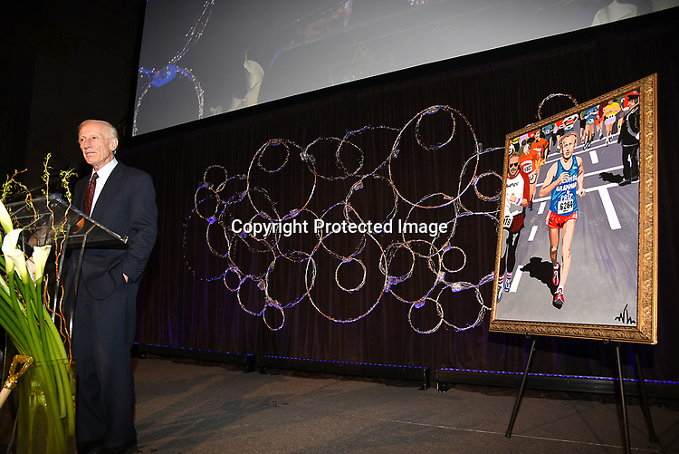 Dr Richard Soghoian and the portrait of him speaking at the Columbia Grammar & Prep School 2017 Benefit on March 8, 2017 at Cipriani Wall Street in New York, New York.