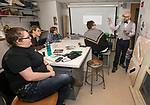 Newsline, Focus on Faculty: DePaul University professor Shane Kelly, right, leads students during a discussion about proper stage rigging, Friday, Jan. 26, 2018, during a class at The Theatre School. Kelly is a professor and chair of design and technology at TTS. The students are, left to right: Tessa Keller, Brendan, Claire Benard and Nic McNulty. DePaul University/Jamie Moncrief) (See Special Instructions sections for additional student ID information)