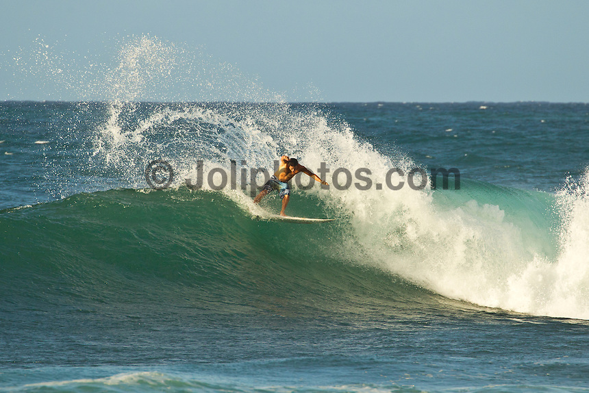 North Shore/Oahu/Hawaii (Monday, November 21, 2011) Adriano de Souza (BRA)  injured his right knee while free surfing at Off The Wall, on the  North Shore today.. Photo: joliphotos.com