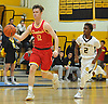 Kyle Murphy #12 of Chaminade, left, dribbles downcourt as Jevon Burke #2 of St. Anthony's guards him during a CHSAA varsity boys basketball game at St. Anthony's High School on Friday, Jan. 20, 2017.