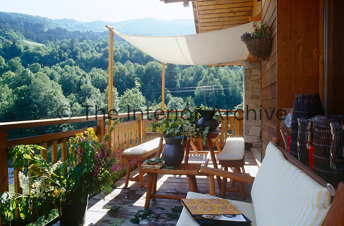 The veranda has views over the surrounding woods and mountains