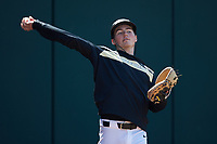 Wake Forest bullpen catcher Landon Dombrowski (14) warms up the starting pitcher prior to the game against the Furman Paladins at BB&T BallPark on March 2, 2019 in Charlotte, North Carolina. The Demon Deacons defeated the Paladins 13-7. (Brian Westerholt/Four Seam Images)