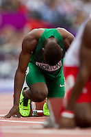 03 AUG 2012 - LONDON, GBR - Amaechi Morton (NGR) of Nigeria  prepares for the start of his men's 400m hurdles heat during the London 2012 Olympic Games athletics at the Olympic Stadium in the Olympic Park in Stratford, London, Great Britain .(PHOTO (C) 2012 NIGEL FARROW)