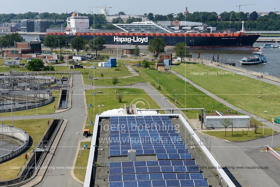 GERMANY, Hamburg, water treatment plant of Hamburg Wasser at river Elbe, solar modules and container ship of Hapag Lloyd / DEUTSCHLAND, Hamburg Wasser, Klaeranlage Koehlbrandhoeft an der Norderelbe, Solaranlage, Hapag Lloyd Containerschiff und Docklands