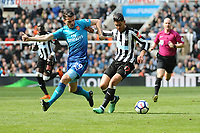 Ayoze Perez of Newcastle United battles with Granit Xhaka of Arsenal during Newcastle United vs Arsenal, Premier League Football at St. James' Park on 15th April 2018