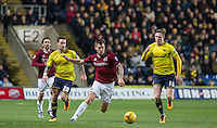 James Collins of Northampton Town under pressure from John Lundstram (right) of Oxford United during the Sky Bet League 2 match between Oxford United and Northampton Town at the Kassam Stadium, Oxford, England on 16 February 2016. Photo by Andy Rowland.