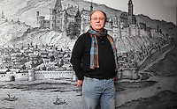 Francois Blary, teacher-researcher at the Universite de Picardie Jules Verne, laboratoire TRAME (Textes, Representations, Archeologie, Autorite et Memoires de líAntiquite a la Renaissance), in front of a large panel with an illustration of the town and castle of Chateau-Thierry, after a late 16th century drawing, in the education room of the medieval castle of Chateau-Thierry, Picardy, France.  Picture by Manuel Cohen
