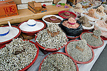 Dried fish, shrimp, seafood, and a variety of spices on display in a market stall found in Wonju, Korea