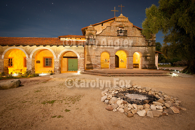Night time light painting of the front façade of the Chapel and colonnades using moonlight and flashlight at Mission San Antonio de Padua, California.