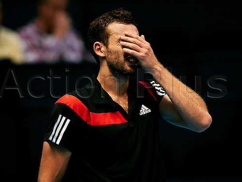 23.10.2013. Valencia, Spain.  Ernests Gulbis of Latvia reacts during the game between Simon Gilles of France and Alejandro Falla of Colombia during  the Valencia Open 500 Tennis Tournament at the Agora Building