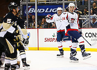 John Carlson #74 of the Washington Capitals celebrates his goal in the first period against the Pittsburgh Penguins during the game at Consol Energy Center in Pittsburgh, Pennsylvania on December 14, 2015. (Photo by Jared Wickerham / DKPS)