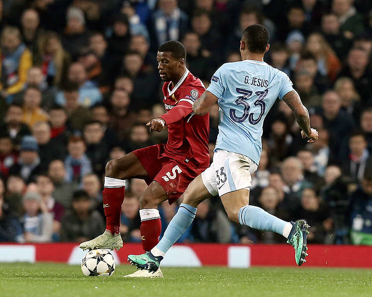 Liverpool's Georginio Wijnaldum under pressure from Manchester City's Gabriel Jesus<br /> <br /> Photographer Rich Linley/CameraSport<br /> <br /> UEFA Champions League Quarter-Final Second Leg - Manchester City v Liverpool - Tuesday 10th April 2018 - The Etihad - Manchester<br />  <br /> World Copyright &copy; 2017 CameraSport. All rights reserved. 43 Linden Ave. Countesthorpe. Leicester. England. LE8 5PG - Tel: +44 (0) 116 277 4147 - admin@camerasport.com - www.camerasport.com