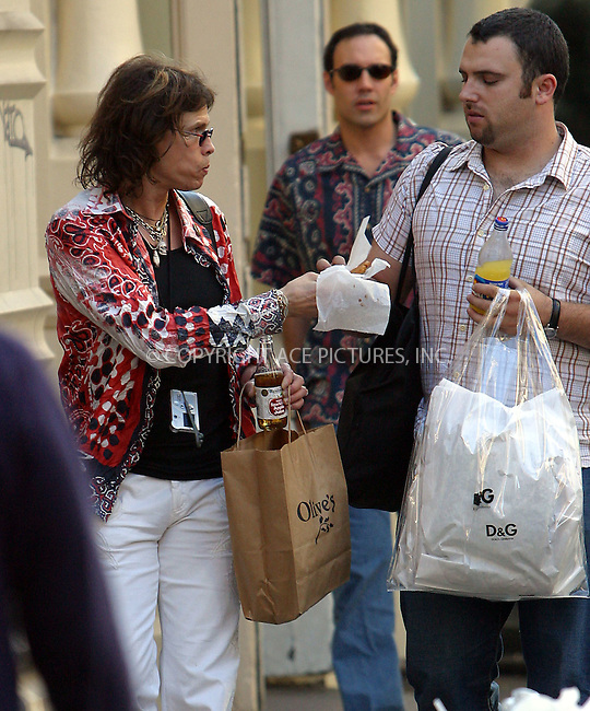 Steven Tyler with his wife Teresa Barrick, a family friend and bodyguard on a shopping spree in New York's trendy SoHo. Perhaps Steven shopped 'till he dropped as he stopped at a local coffee shop and refuelled himself and his bodyguard with cookies and soda. New York, April 27, 2003. Please byline: Alecsey Boldeskul/NY Photo Press.   ..*PAY-PER-USE*      ....NY Photo Press:  ..phone (646) 267-6913;   ..e-mail: info@nyphotopress.com
