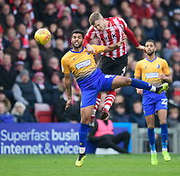 Lincoln City's Michael O'Connor vies for possession with Mansfield Town's Jacob Mellis<br /> <br /> Photographer Chris Vaughan/CameraSport<br /> <br /> The EFL Sky Bet League Two - Lincoln City v Mansfield Town - Saturday 24th November 2018 - Sincil Bank - Lincoln<br /> <br /> World Copyright &copy; 2018 CameraSport. All rights reserved. 43 Linden Ave. Countesthorpe. Leicester. England. LE8 5PG - Tel: +44 (0) 116 277 4147 - admin@camerasport.com - www.camerasport.com