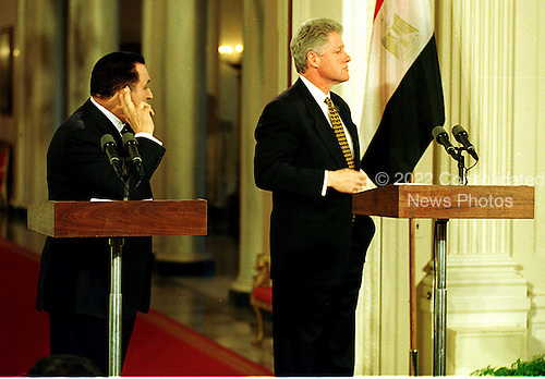 President Hosni Mubarak of Egypt, left, strains to listen to a reporter's question during a joint press confrence with United States President Bill Clinton, right, in the East Room of the White House in Washington, D.C. on Monday, March 10, 1997..Credit: Ron Sachs / CNP