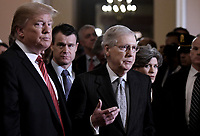 United States Senate Majority Leader Mitch McConnell (Republican of Kentucky) speaks to the press as US President Donald J. Trump (L) looks on after the Republican luncheon at the US Capitol Building on January 9, 2019 in Washington, DC. In the background are US Senator Todd Young (Republican of Indiana), left, and United States Senator Joni Ernst (Republican of Iowa), right. Photo Credit: Olivier Douliery/CNP/AdMedia