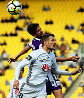 Dario Vidisic and Andreu Guerao compete for a header during the A-League football match between Wellington Phoenix and Perth Glory at Westpac Stadium in Wellington, New Zealand on Sunday, 12 November 2017. Photo: Dave Lintott / lintottphoto.co.nz