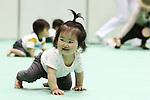 May 8, 2010 - Tokyo, Japan - Babies race a 10 meters crawling competition called 'Babylympic' during the Maternity & Baby Festa 2010 show at Tokyo Big Sight, Japan, on May 8, 2010.Nearly 20,000 people are expected to attend the two-days annual event which features this season's maternity fashions, kids gear, pregnancy information sessions, maternity and exercise workshops for new mothers.