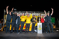 Nov 11, 2018; Pomona, CA, USA; NHRA funny car driver J.R. Todd celebrates with crew after clinching the 2018 funny car world championship during the Auto Club Finals at Auto Club Raceway. Mandatory Credit: Mark J. Rebilas-USA TODAY Sports