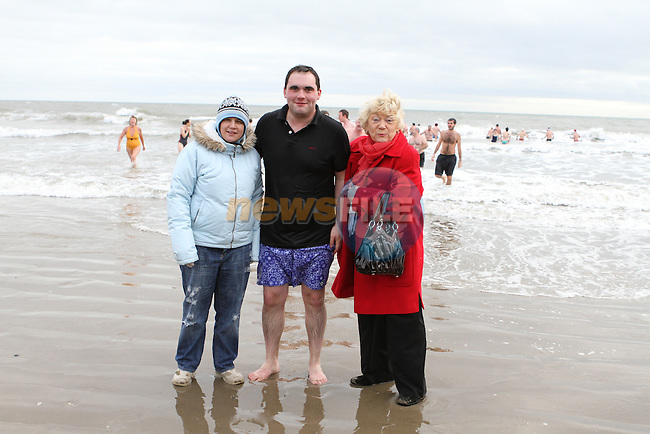 Natasha with Mayor Kevin Callan and Isabel San Roma at the Stephens Day Swim at Clogherhead Beach...(Photo credit should read Jenny Matthews www.newsfile.ie)....This Picture has been sent you under the conditions enclosed by:.Newsfile Ltd..The Studio,.Millmount Abbey,.Drogheda,.Co Meath..Ireland..Tel: +353(0)41-9871240.Fax: +353(0)41-9871260.GSM: +353(0)86-2500958.email: pictures@newsfile.ie.www.newsfile.ie.
