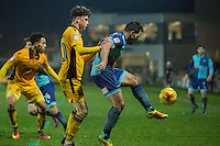Sam Wood of Wycombe Wanderers controls the ball under pressure from Tom Owen-Evans of Newport County during the Sky Bet League 2 match between Newport County and Wycombe Wanderers at Rodney Parade, Newport, Wales on 22 November 2016. Photo by Mark  Hawkins.