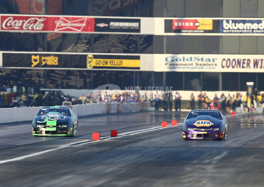 Feb 13, 2016; Pomona, CA, USA; NHRA pro stock driver Alex Laughlin (left) races alongside Vincent Nobile during qualifying for the Winternationals at Auto Club Raceway at Pomona. Mandatory Credit: Mark J. Rebilas-USA TODAY Sports