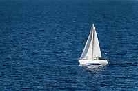 Small sailboat in the Mediterranean Ocean, Italy.