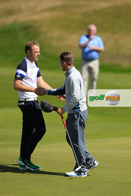 Paul McBride (The Island) &amp; Keith Egan (Carton House) shaking hands on the 17th green during Matchplay Round 3 of the South of Ireland Amateur Open Championship at LaHinch Golf Club on Saturday 25th July 2015.<br /> Picture:  Golffile | TJ Caffrey