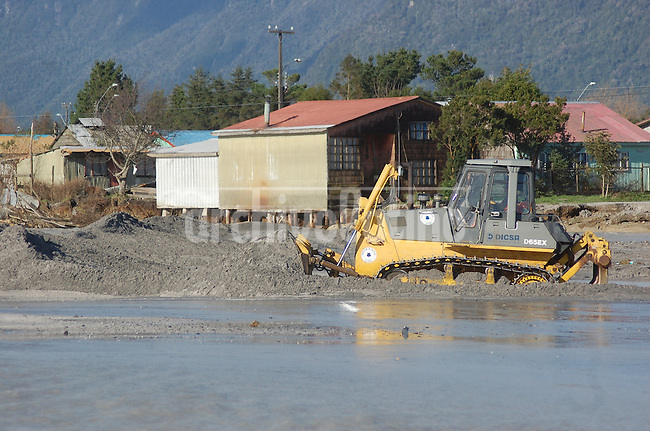 Destruction at the flooded and covered with ashes Chaiten town in southern Chile . Chaiten Volcano started erupting on May 2 for the first time in thousands of years, spewing ash, gas and molten rock. Experts have said it could erupt at a less volatile pace for months and even years.