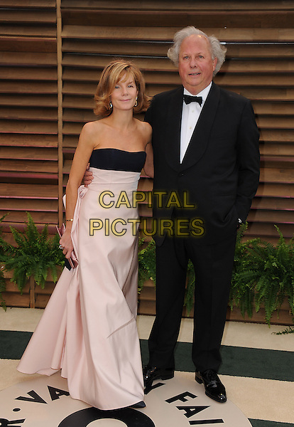 WEST HOLLYWOOD, CA - MARCH 2: Anna Scott, Graydon Carter arrive at the 2014 Vanity Fair Oscar Party in West Hollywood, California on March 2, 2014. <br /> CAP/MPI/MPI213<br /> &copy;MPI213 / MediaPunch/Capital Pictures