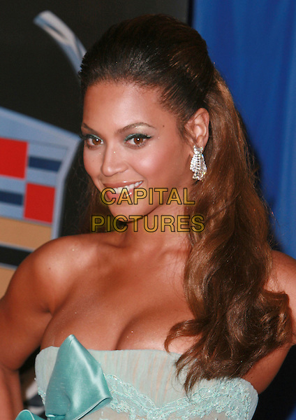 "BEYONCE KNOWLES.""Dreamgirls"" - Los Angeles Premiere,.at the Wilshire Theatre, Beverly Hills, California, .USA, December 11th 2006..portrait headshot strapless blue green dress earrings.CAP/ADM/CH.©Charles Harris/Admedia/Capital Pictures"