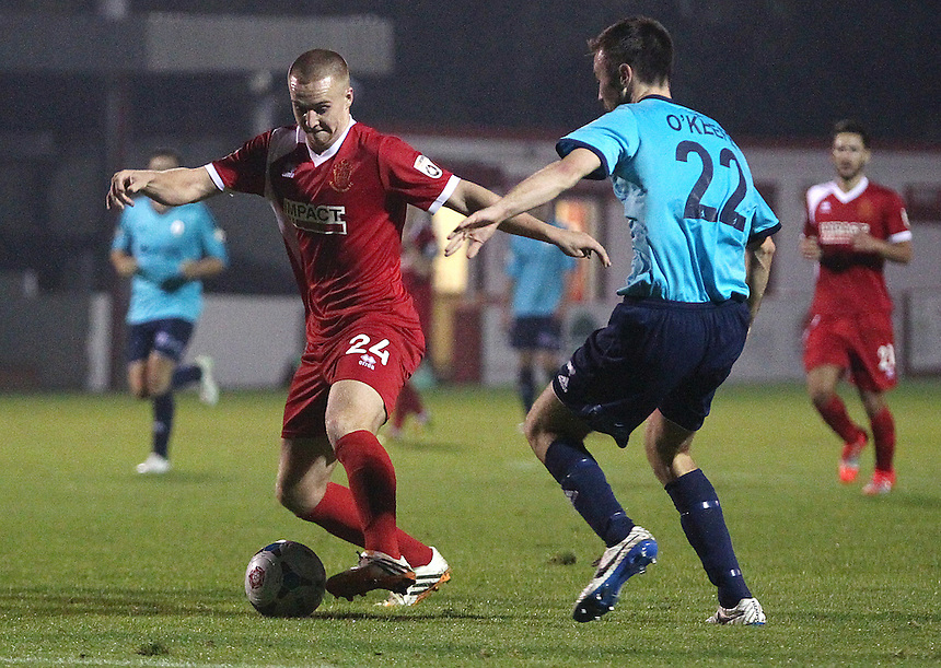 Alfreton Town&rsquo;s David Mellor under pressure from AFC Telford United's Josh O&rsquo;Keefe<br /> <br /> Photo by Rich Linley/CameraSport<br /> <br /> Football - English Football Vanarama Conference Premier League - Alfreton Town v AFC Telford United - Tuesday 16th September 2014 - Impact Arena - Alfreton<br /> <br /> &copy; CameraSport - 43 Linden Ave. Countesthorpe. Leicester. England. LE8 5PG - Tel: +44 (0) 116 277 4147 - admin@camerasport.com - www.camerasport.com
