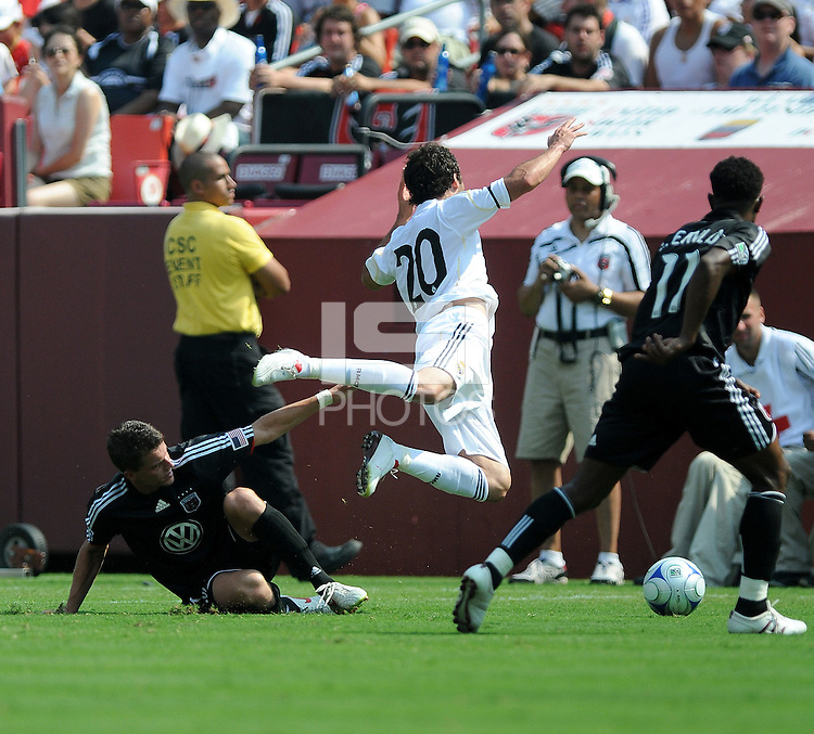DC United defender Marc Burch (4) versus Real Madrid forward Gonzalo Higuain (20). Real Madrid defeated DC United 3-0 at FedEx Field, Sunday August 9, 2009 in an International Friendly.