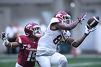 NWA Democrat-Gazette/J.T. WAMPLER Arkansas wide receiver Tyson Morris hauls in a pass in front of defensive back Korey Hernandez Saturday April 29, 2017 during a red-white scrimmage. The scheduled practice was closed to the general public and moved indoors because of thunderstorms.