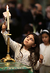 Palestinian Christians take part in a mass marking the Palm Sunday at the Church of Saint Porphyrius at the Nativity church in the West Bank city of Bethlehem, on April 21, 2019. Photo by Ahmed Mezher/ WAFA