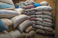 Family Bags of Millet in Storehouse, Bijam, a Wolof Village, near Kaolack, Senegal.  Many family names are written in the Arabic alphabet.