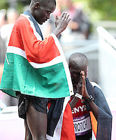 12.08.2012. London, England. Silver medalist Abel Kirui of Kenya l and Bronze medalist Wilson Kipsang Kiprotich of Kenya are exhausted After the mens Marathon Competition  London 2012 Olympic Games X