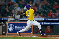 Saul Garza (13) of the LSU Tigers follows through on his swing against the Oklahoma Sooners in game seven of the 2020 Shriners Hospitals for Children College Classic at Minute Maid Park on March 1, 2020 in Houston, Texas. The Sooners defeated the Tigers 1-0. (Brian Westerholt/Four Seam Images)