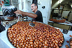 A Palestinian man prepares traditional sweets during the first day of the holy fasting month of Ramadan, in the West Bank city of Nablus on July 23, 2013. Photo by Issam Rimawi.