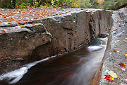 """A section of a rocky gorge just above the """"other"""" Pitcher Falls on the South Fork of the Hancock Branch in Lincoln, New Hampshire USA during the autumn months. This brook is located near the Kancamagus Highway in the White Mountains region of New Hampshire."""