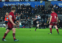 Luke Price of Ospreys kicks a penalty during the Guinness Pro14 Round 16 match between Ospreys and Munster Rugby at the Liberty Stadium in Swansea, Wales, UK. Friday 22 February 2019