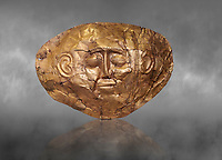 Mycenaean gold death mask, Grave Cicle A, Mycenae, Greece. National Archaeological Museum of Athens.   Grey Art Background<br /> <br /> This death mask is typical of the other Mycenaean gold death masks fround in Grave V. made from a sigle sheet of gold the shape of the face would have been hammered ot against wood. two holes either side of the gold mask allowed it to be held over the dead mans face. As weapons were found in the graves of Grave Circle A at Mycenae, those buried here wer warriors and maybe kings as the grave goods buried with them were of great value. 16th century BC