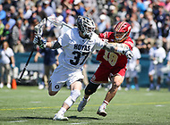 Washington, DC - March 31, 2018: Georgetown Hoyas Massimo Bucci (37) is being defended by Denver Pioneers Danny Logan (19) during game between Denver and Georgetown at  Cooper Field in Washington, DC.   (Photo by Elliott Brown/Media Images International)