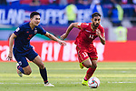 Ali Jaafar Madan of Bahrain (R) runs with the ball as Suphan Thongsong of Thailand (L) follows during the AFC Asian Cup UAE 2019 Group A match between Bahrain (BHR) and Thailand (THA) at Al Maktoum Stadium on 10 January 2019 in Dubai, United Arab Emirates. Photo by Marcio Rodrigo Machado / Power Sport Images