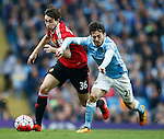 Matteo Darmian of Manchester United tussles with David Silva of Manchester City during the Barclays Premier League match at The Etihad Stadium. Photo credit should read: Simon Bellis/Sportimage