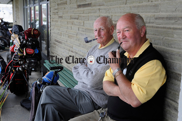 Retired Bank managers Cyril Kelly and Paul Walsh await their tee times at the Friends of Ennistymon Hospital Golf Classic at Lahinch Golf Club. Photograph by John Kelly.