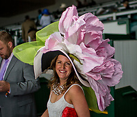 LOUISVILLE, KY - MAY 06: A woman wears a massive hat on Kentucky Derby Day at Churchill Downs on May 6, 2017 in Louisville, Kentucky. (Photo by Douglas DeFelice/Eclipse Sportswire/Getty Images)