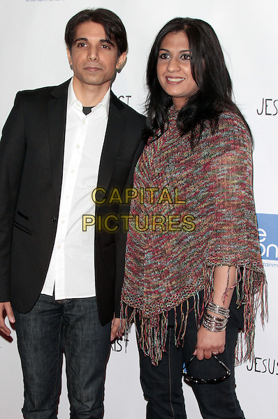 Simon Taufique and Shilpa Taufique.'Jesus Henry Christ' Los Angeles Premiere held at Mann Chinese 6, Hollywood, California, USA..April 18th, 2012.half length black suit poncho knitted red white shirt married husband wife jeans denim.CAP/ADM/SLP/JO.©James Orken/Starlitepics/AdMedia/Capital Pictures.