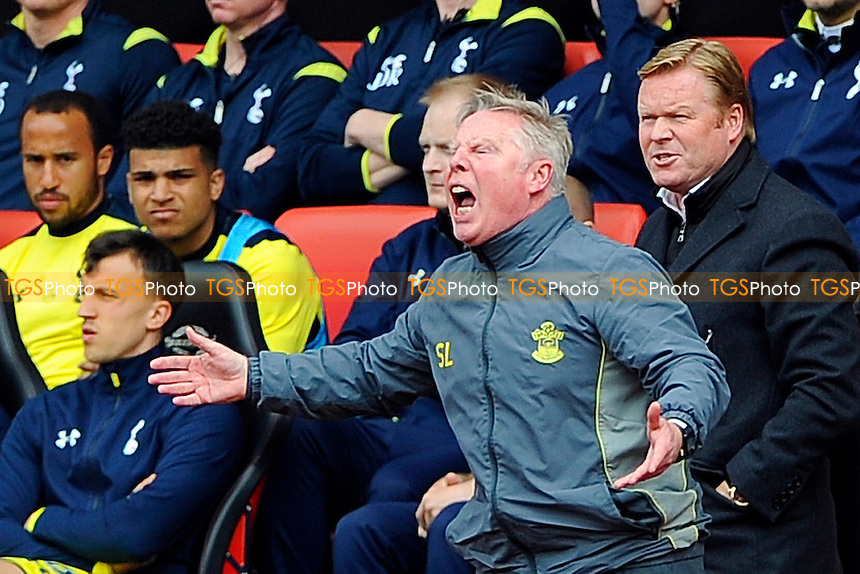 Southampton assistant Sammy Lee and Southampton Manager Ronald Koeman right have issues with a decision - Southampton vs Tottenham Hotspur - Barclays Premier League Football at St Mary's Stadium, Southampton, Hampshire - 25/04/15 - MANDATORY CREDIT: Denis Murphy/TGSPHOTO - Self billing applies where appropriate - contact@tgsphoto.co.uk - NO UNPAID USE