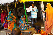 A trainer speaks with pregnant woman and tells them about health issues at the delivery hut in Barwa village of East Champaran district of Bihar, India. Initiated to provide better pre-natal care to the pregnant women, Duncan Hospital with collaboration with Geneva Global has initiated a special campaign - delivery hut. Villagers here are told about various health issues, women go through free pre-natal check ups etc. Since 2008 the Foundation and Geneva Global have been investing in the training of medical staff to improve the lives of people living in 600+ villages in the region. The NGOs are delivering cost effective interventions to address treatment, care and prevention of diseases, disability and preventable deaths amongst infants, adolescent girls and women of child-bearing age. There is statistical and anecdotal evidence that there have been vast improvements and a total of 40-50% increased immunization for all children under 6 has meant that communities can be serviced and educated long term. Photograph: Sanjit Das/Panos for Legatum Foundation